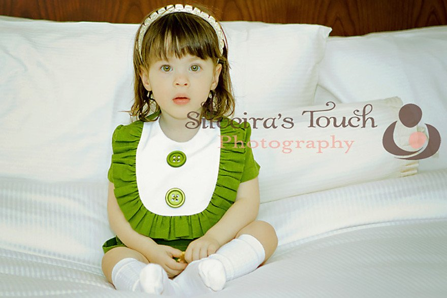 NY Family photographer of baby girl wearing green holiday dress
