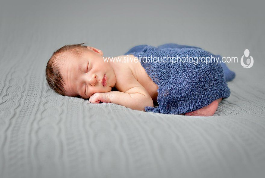 photo of baby boy sleeping on blanket