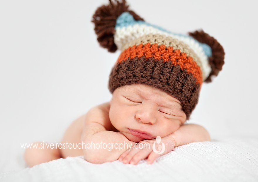 North Haledon NJ Newborn photography of baby wearing a puff hat