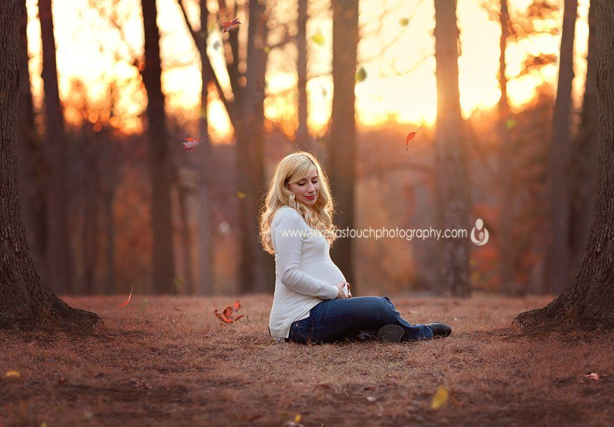 Verona NJ Maternity photography of pregnant mom sitting on ground with sunset behind her.