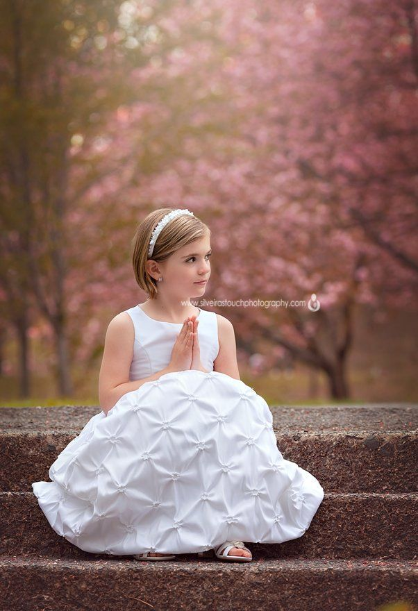 Communion Photography of girl sitting on steps NJ cherry blossoms