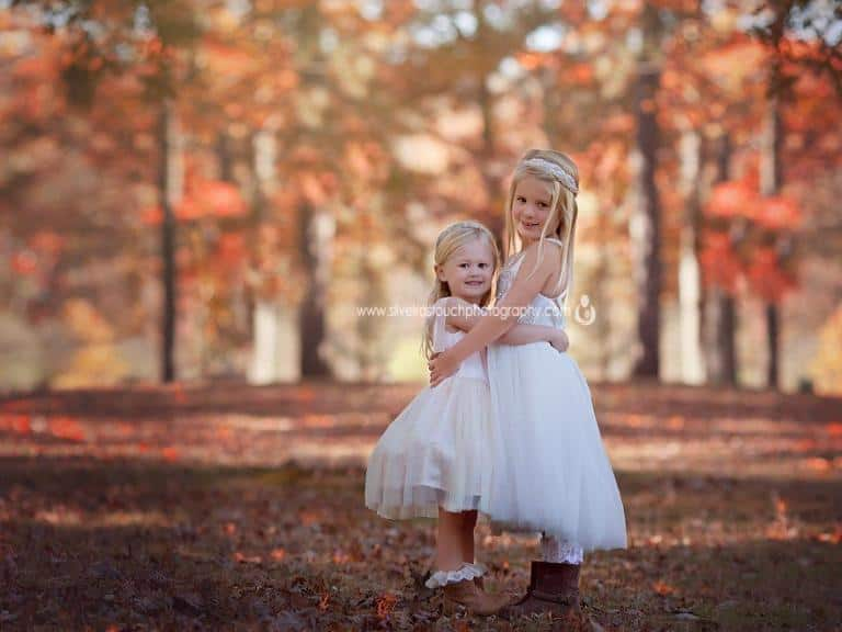 portrait of two girl cousin hugging