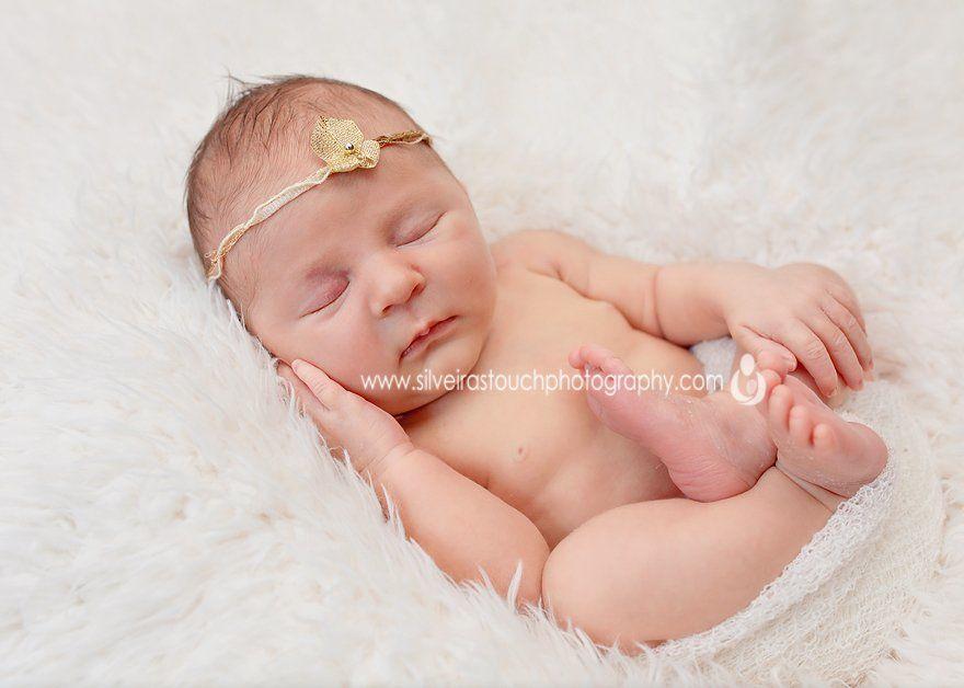 sleeping newborn hand on face