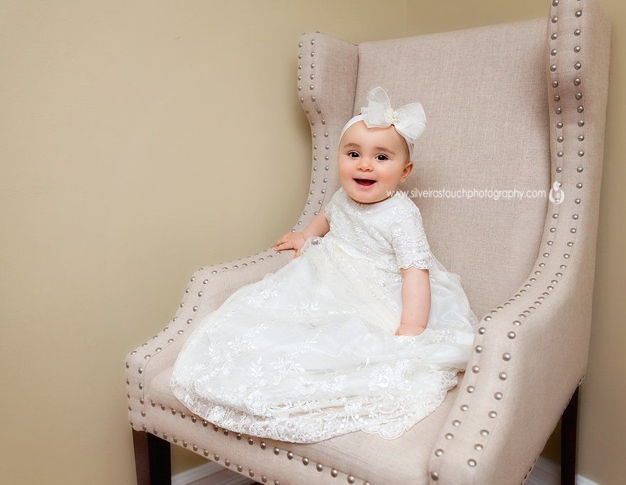 Christening baby Photography NJ of smiling girl wearing Christening gown
