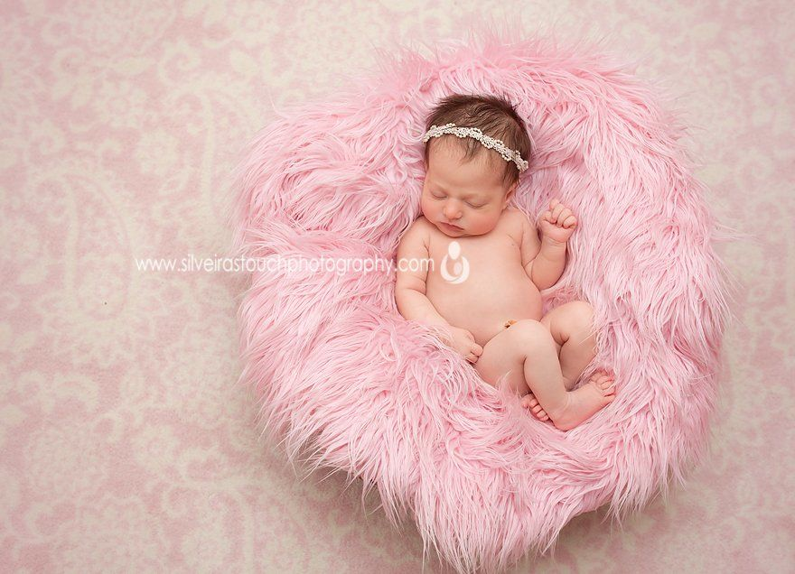 Livingston NJ newborn photography of baby girl laying on pink fur prop