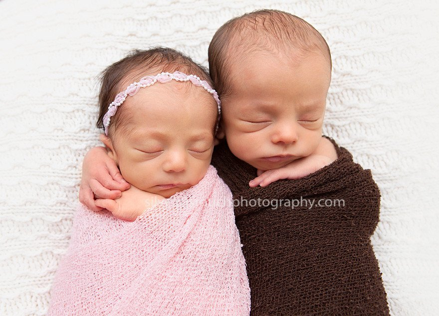 Twins miracle babies hugging each other and sleeping