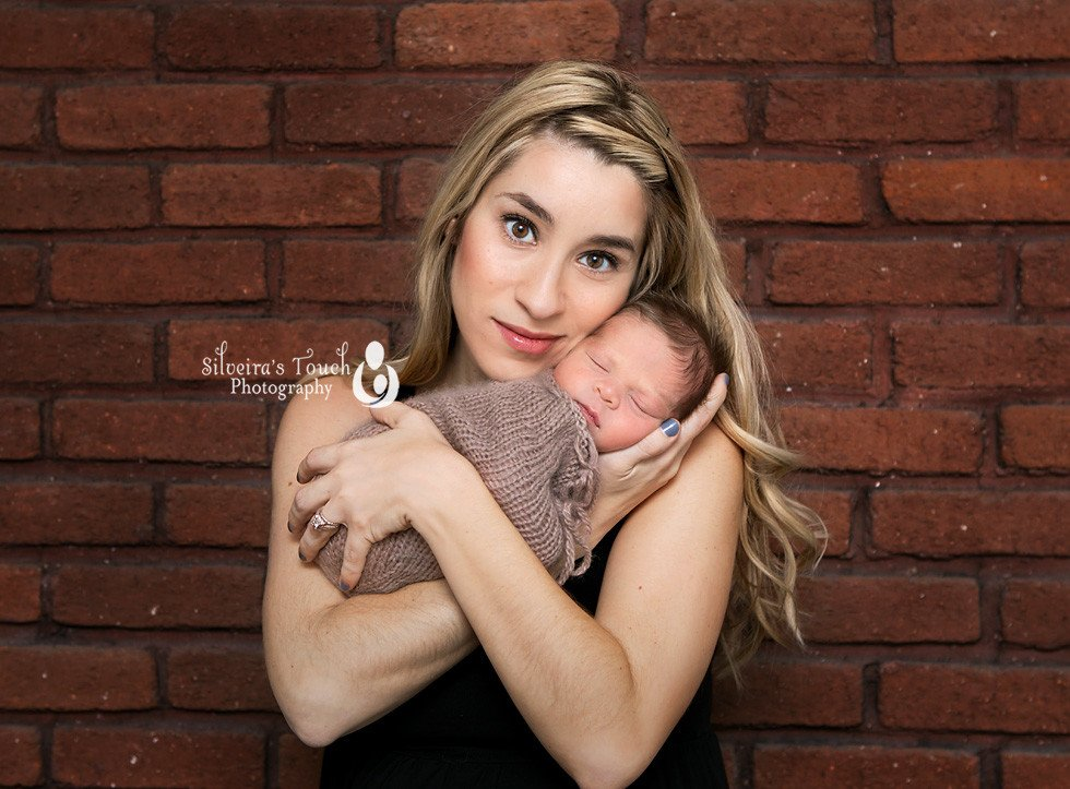 Mom holding newborn photography