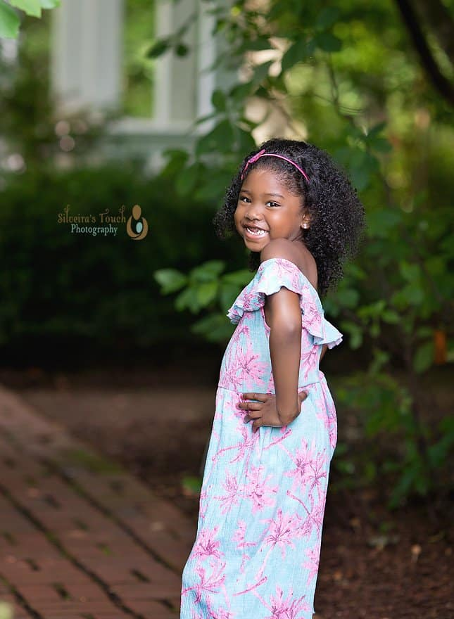 Photo of girl smiling and striking pose in garden
