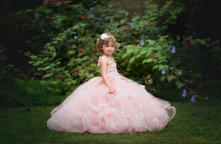 photo of girl wearing couture dress outdoor