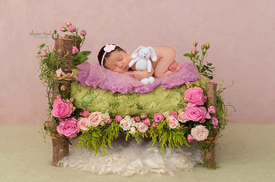 Newborn Photography nj little baby girl on flower bed with bunny