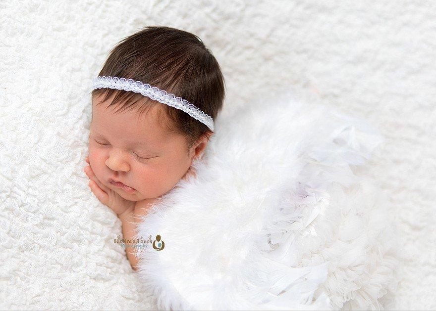 Newborn photography in Nutley of sleeping newborn with Angel wings