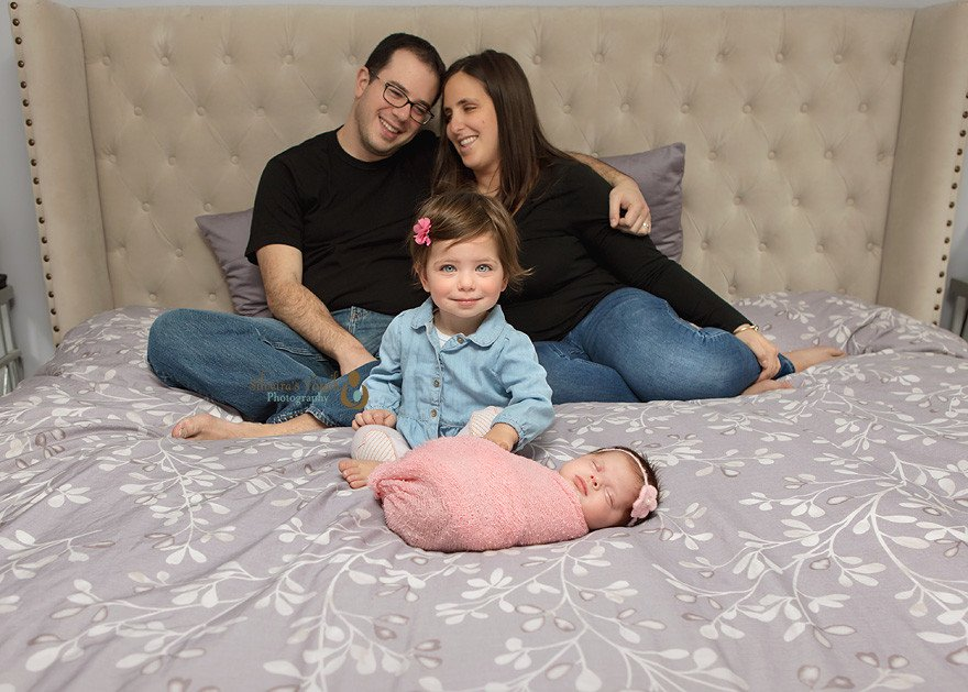 roseland NJ photographer capturing newborn family photos in home