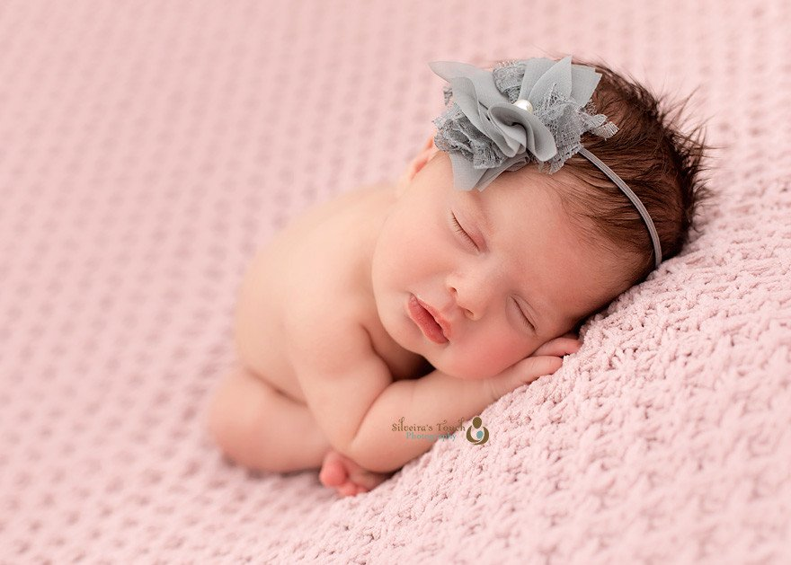 roseland NJ newborn photographer capturing baby on pink blanket sleeping