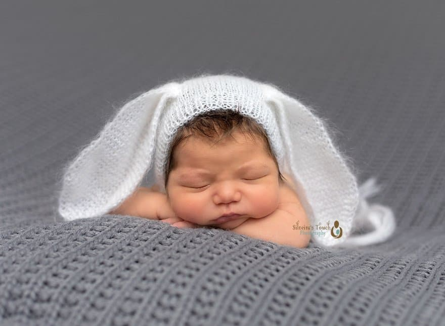 Newborn photography of baby wearing bunny hat