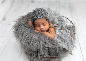 Mt. Olive NJ Newborn photography of baby on fur in basket