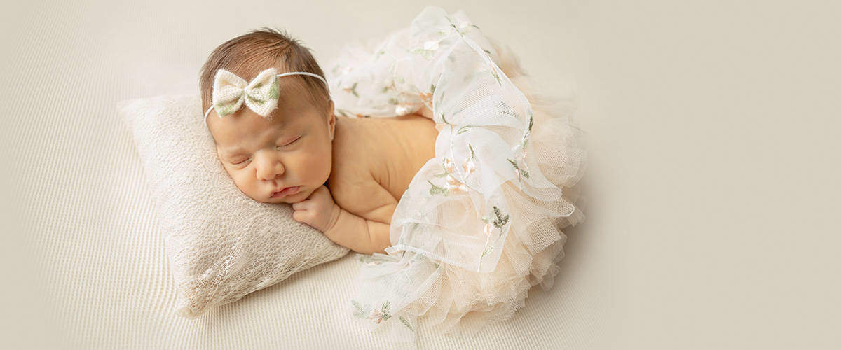 photo of newborn baby in tutu