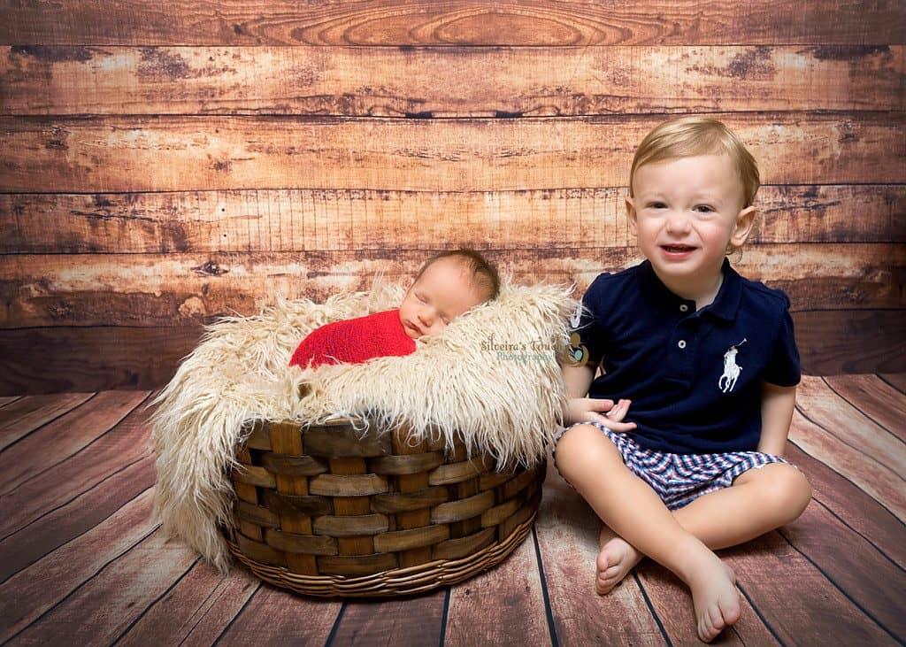 NJ newborn photos of siblings smiling