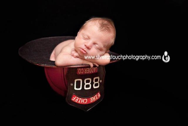 Denville NJ newborn photography of baby boy in Firemen helmet sleeping