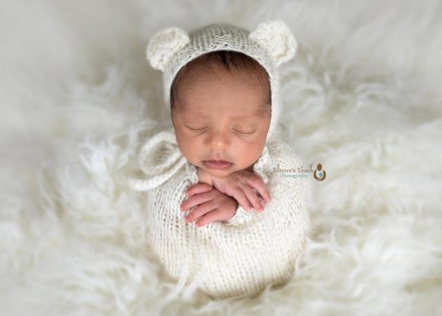 Budd Lake NJ Newborn photography of baby in potato sack pose sleeping on bean bag