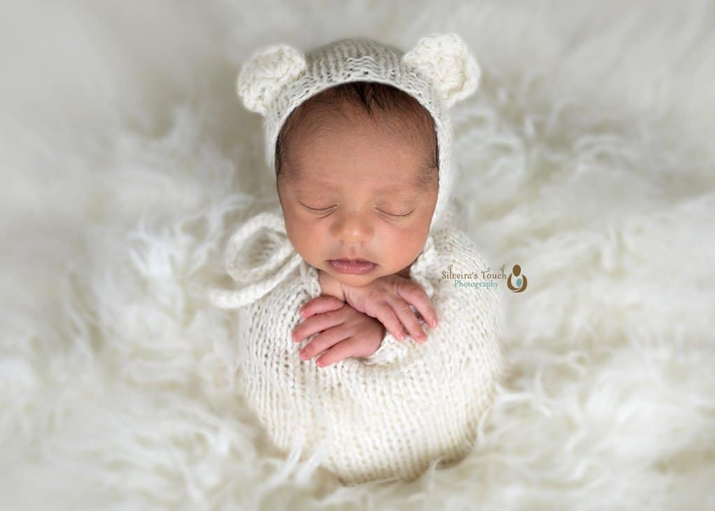 Budd Lake NJ Newborn photography of baby in potato sack pose sleeping on bean bag