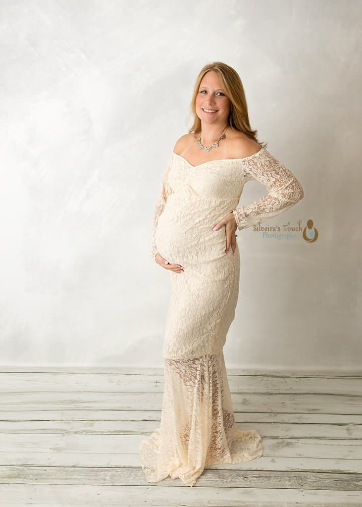 NJ maternity photography of mom wearing a white maternity dress in studio