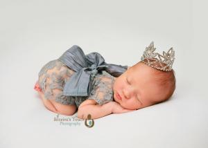 Newborn Photographer in Morris County NJ taken in studio of baby sleeping wearing crown