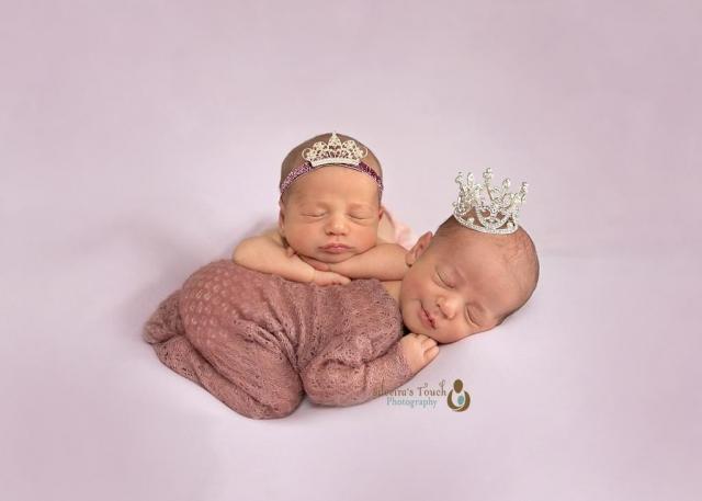 Newborn photography in Morris County NJ of twins girls sleeping wearing a crown