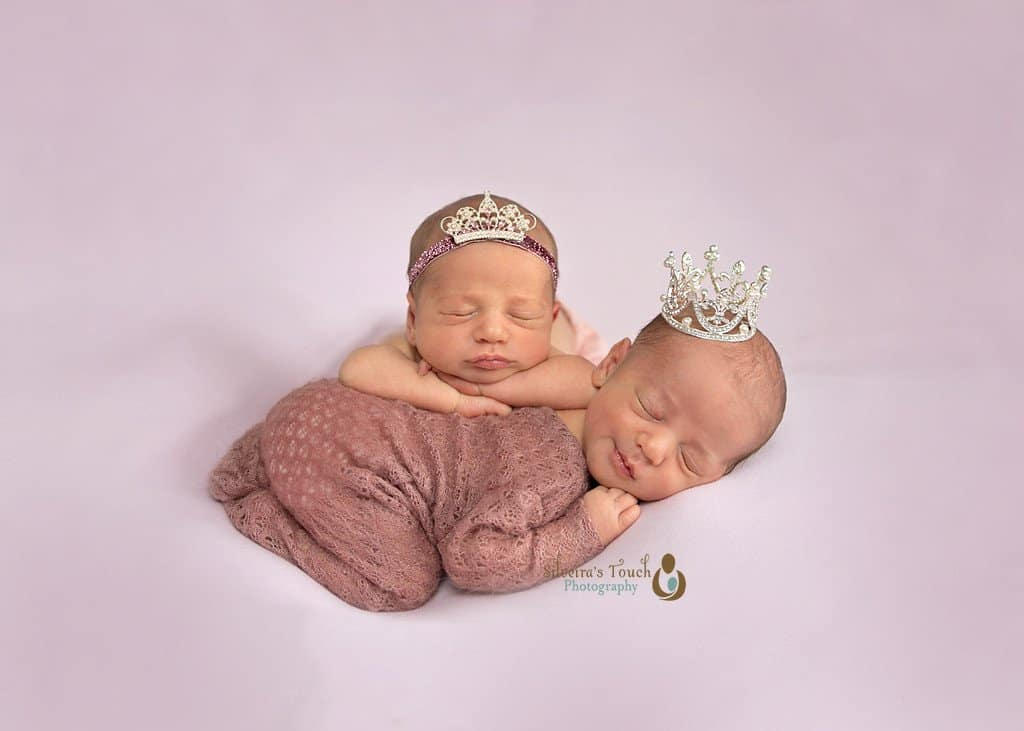 Newborn photography in Morris County NJ of twins girls sleeping wearing a crown