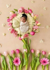 Newborn photography of baby girl on a flower backdrop