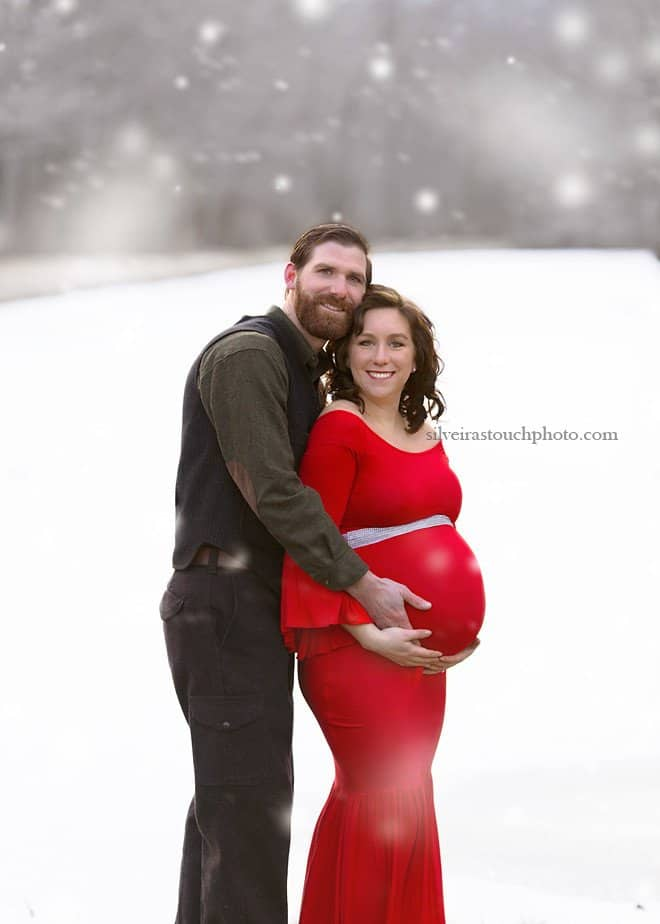 winter maternity photography of mama wearing red dress