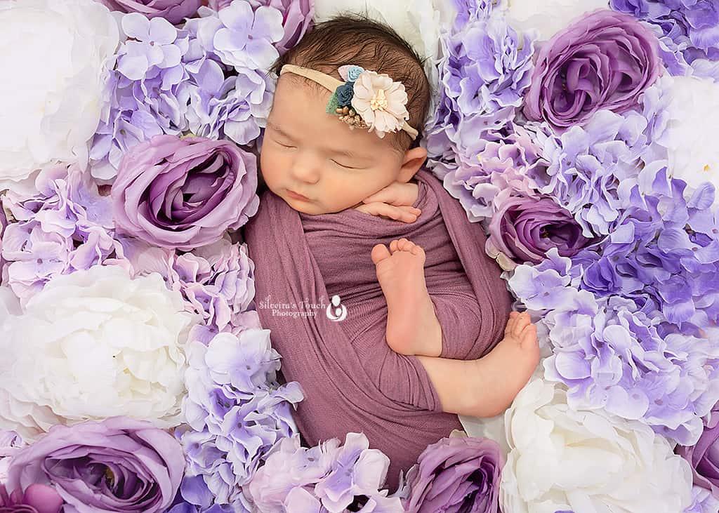 photo of newbonr sleeping on Purple floral