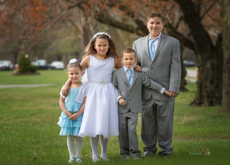 photo of siblings in Communion dress at park