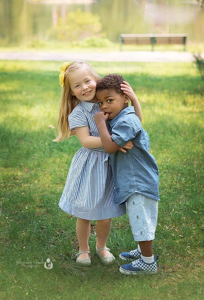 photo of mixed race sibling hugging