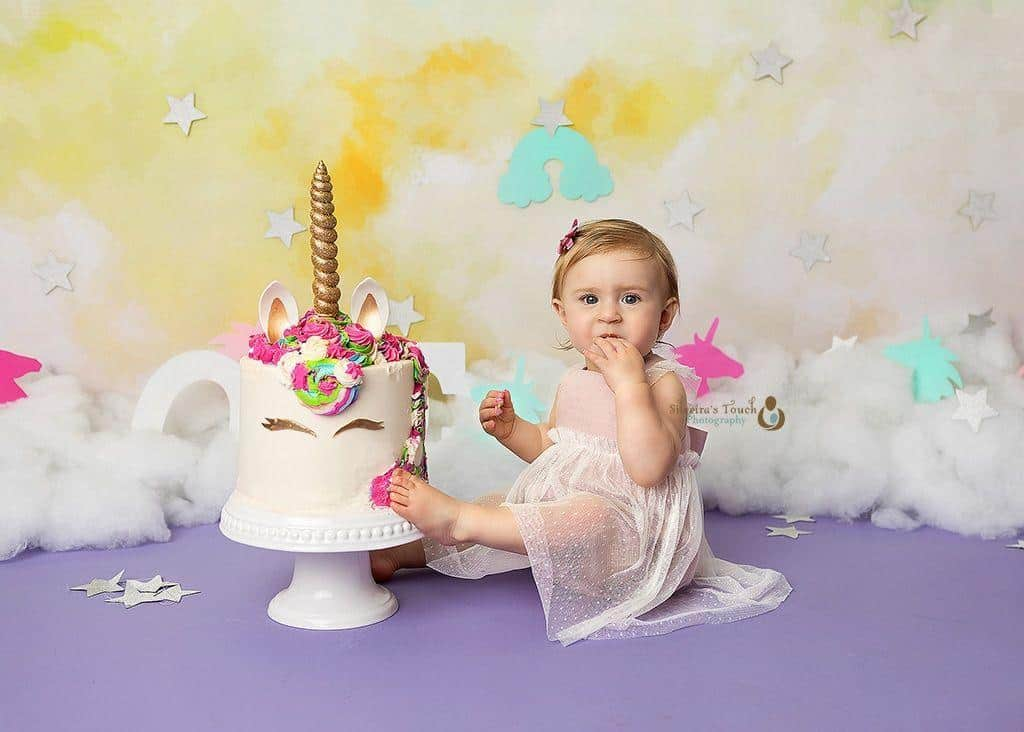 NJ baby photoshoot of birthday girl eating cake