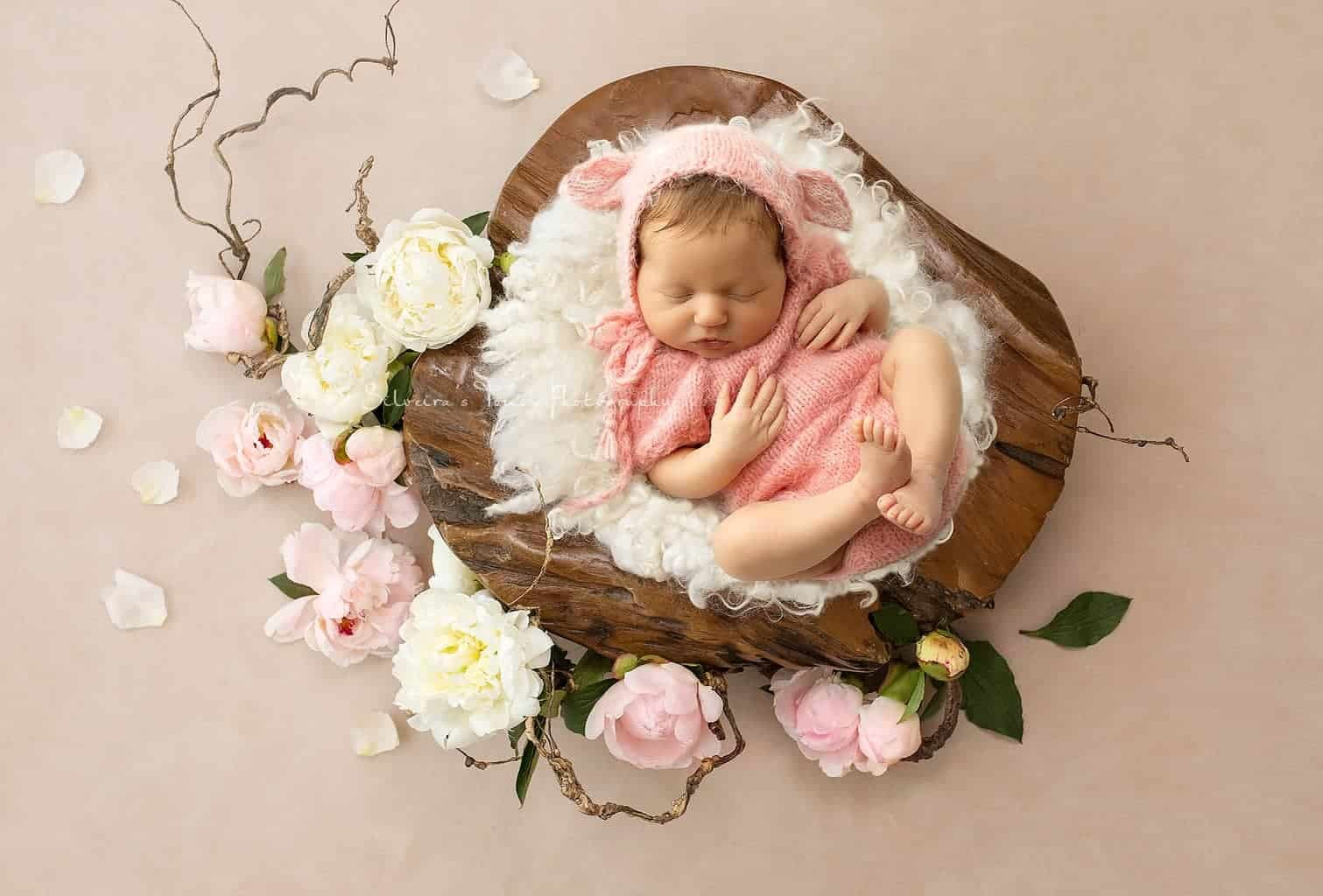 Baby newborn in pink outfit prop