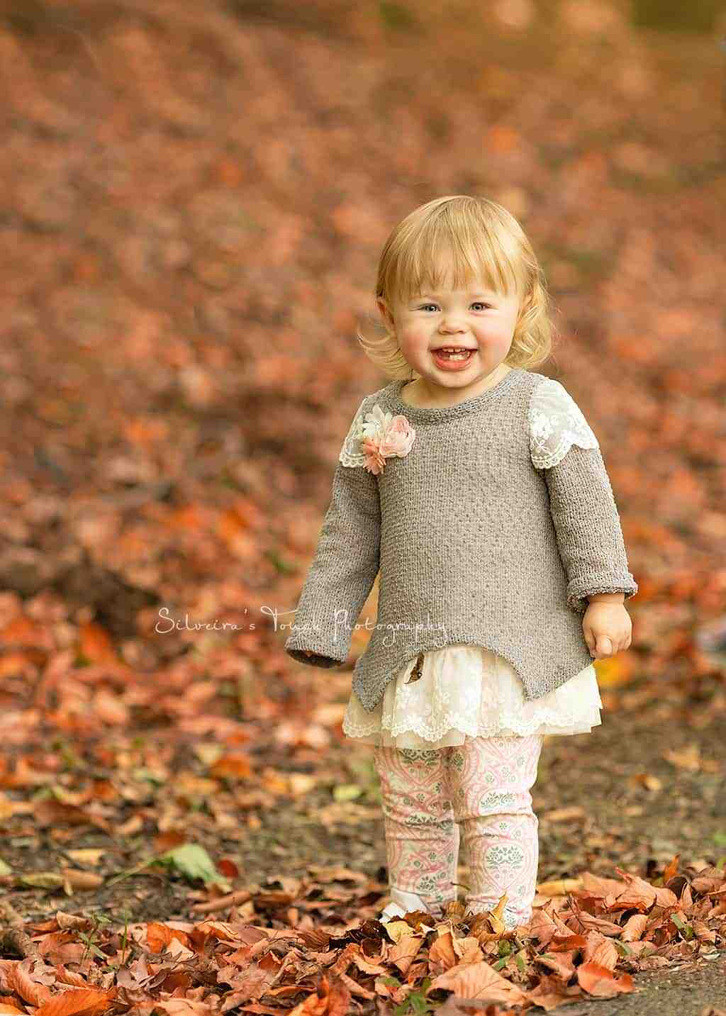 smiling baby girl photo outdoor in the fall