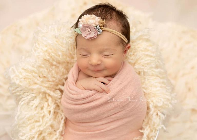 smiling newborn in home session