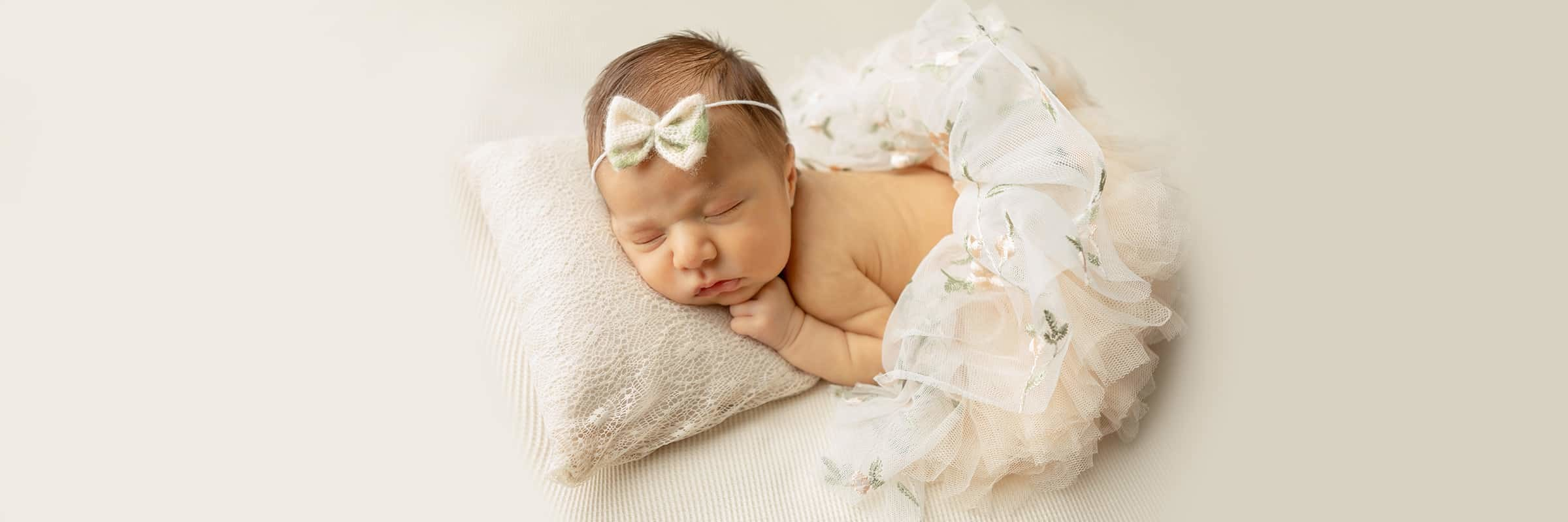 photo of newborn baby girl wearing floral tutu