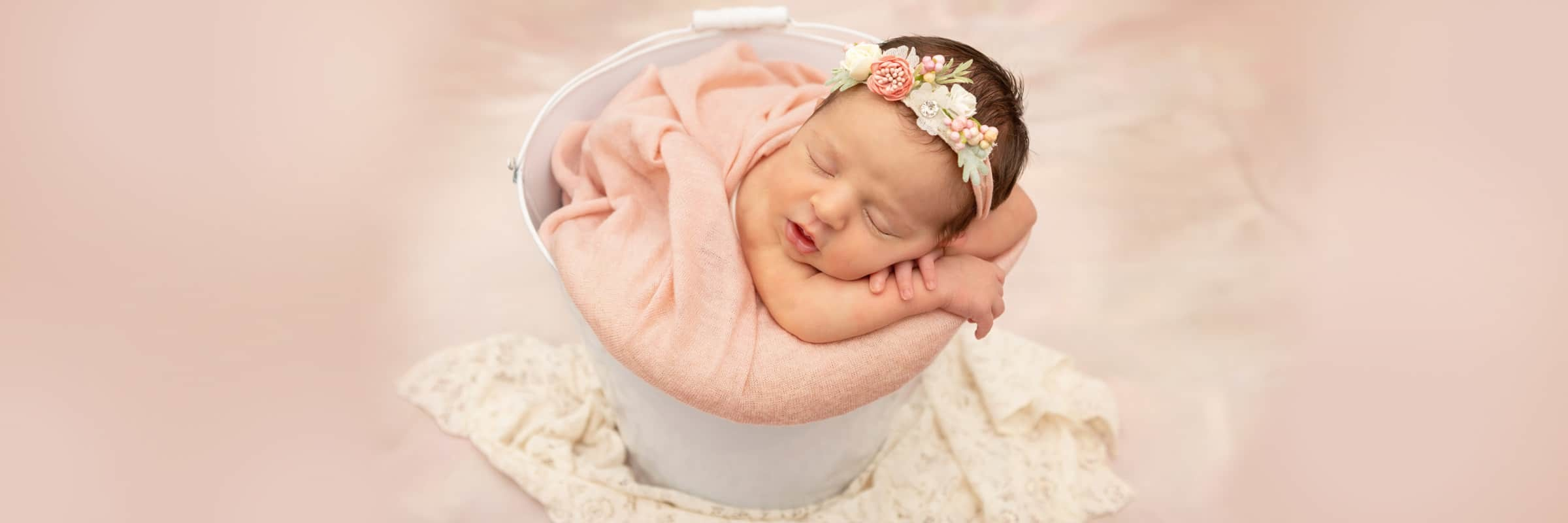 babygirlportrait sleeping in white bucket