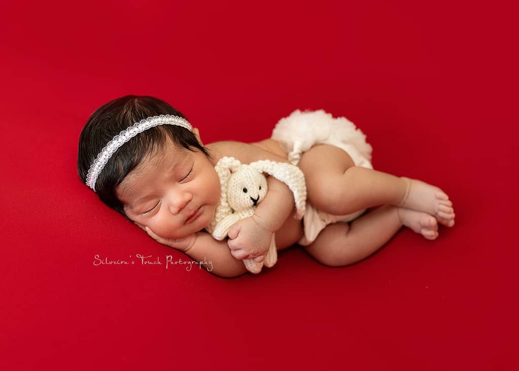 baby photography session with stuffed bunny