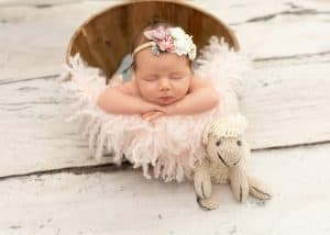 newborn photography baby in rustic bucket